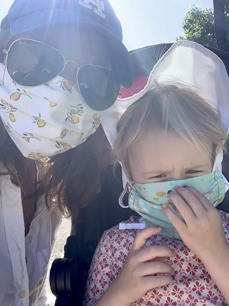 Gretchen Cook with her daughter Wells in masks made by friend Christine Rupert (@bird_in_a_tree on Instagram) whose family has been impacted by COVID-19.