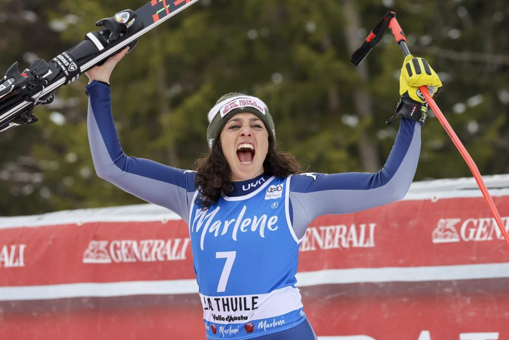In this Feb. 29, 2020 file photo, Italy's Federica Brignone celebrates taking second place in an alpine ski, women's World Cup Super G, in La Thuile, Italy. Amid a worldwide suspension of sports events, Brignone was awaiting a special delivery which arrived last month, with three crystal globes: the big 9-kilogram (20-pound) prize for her first overall World Cup triumph — she's the first Italian woman to win the coveted honor in the 53-year history of the competition -- plus two smaller 3.5-kilogram (8-pound) globes for her season-long giant slalom and Alpine combined titles.