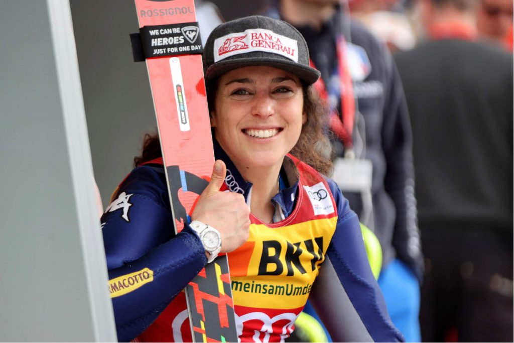 In this Feb. 23, 2020 file photo, Italy's Federica Brignone smiles after completing an alpine ski, women's World Cup alpine combined, in Crans Montana, Switzerland. Amid a worldwide suspension of sports events, Brignone was awaiting a special delivery which arrived last month, with three crystal globes: the big 9-kilogram (20-pound) prize for her first overall World Cup triumph — she's the first Italian woman to win the coveted honor in the 53-year history of the competition -- plus two smaller 3.5-kilogram (8-pound) globes for her season-long giant slalom and Alpine combined titles.