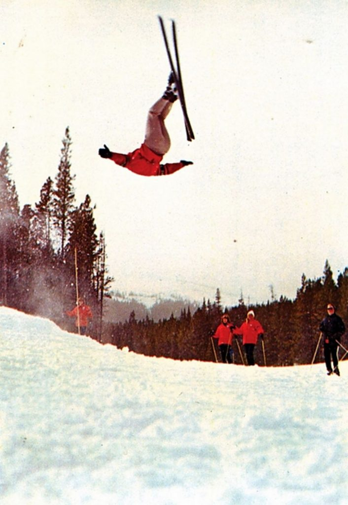 An early Breck postcard features ski school director Trygve Berge doing a flip on Peak 8.