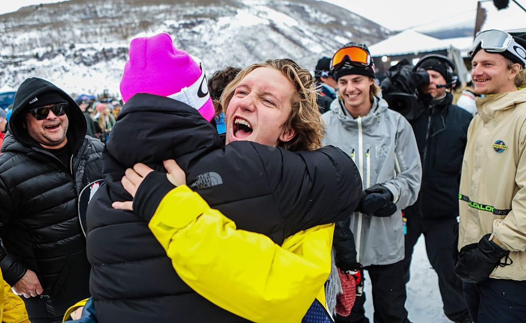 Slopestyle champion Red Gerard gets swarmed by friends and family in the finish area of the Burton US Open men's slopestyle finals in Vail in March 2019.