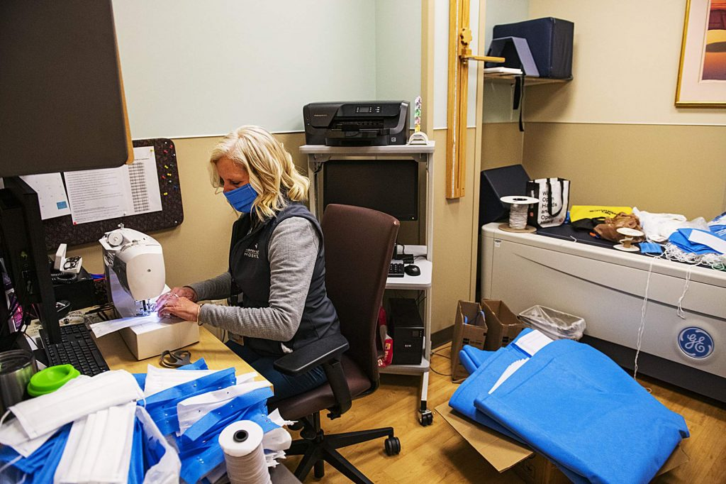 Connie Leonard sews masks in a bone density scanner room at Aspen Valley Hospital on Tuesday, April 14, 2020. Leonard expressed that it's a team effort to make the masks that are now being used at the hospital and there's usually at least four other people helping assemble the PPE. The first 100 masks were made on Leonard's dining room table, now the crew has made over 500 masks since last week. As long as people need masks, explained Leonard, they will continue making them. To help continue making masks, Obermeyer donated elastic. The fabric used is material that surgical trays are wrapped in. (Kelsey Brunner/The Aspen Times)