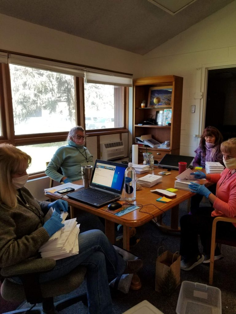 Volunteer election judges for the town of Basalt prepare ballots for counting on Tuesday. In a sign of the times, they wore masks and gloves because of the coronavirus threat.