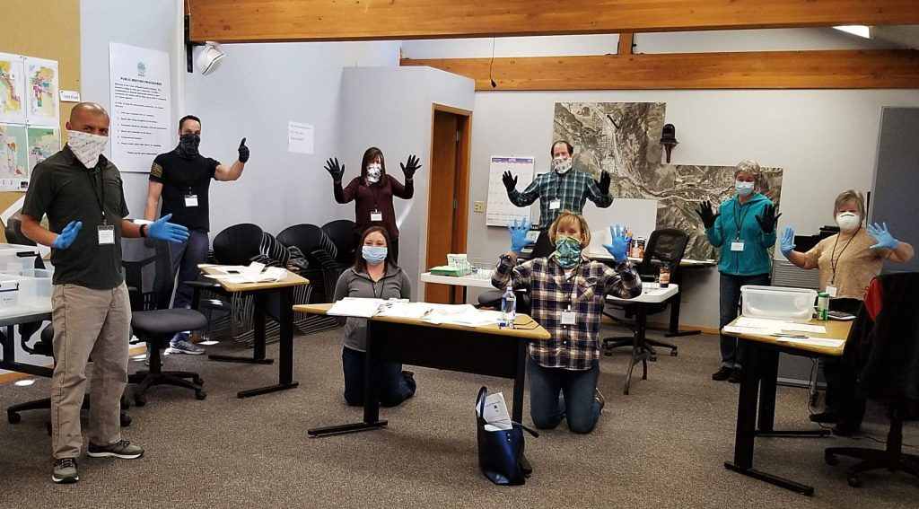 In a sign of the times, volunteer election judges wear mashs and gloves when they report to Basalt Town Hall to process ballots on Tuesday.