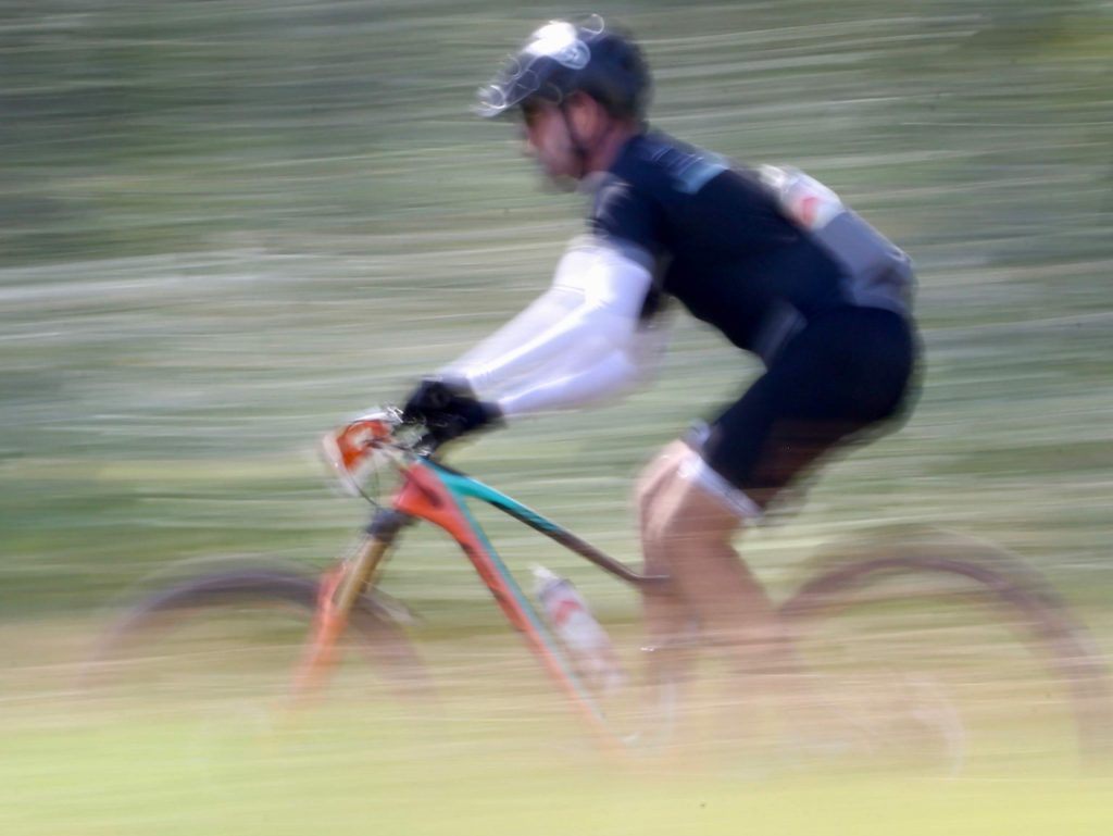 A racer competes in the Audi Power of Four mountain bike race on Saturday, Aug. 17, 2019 in Snowmass. (Photo by Austin Colbert/The Aspen Times)