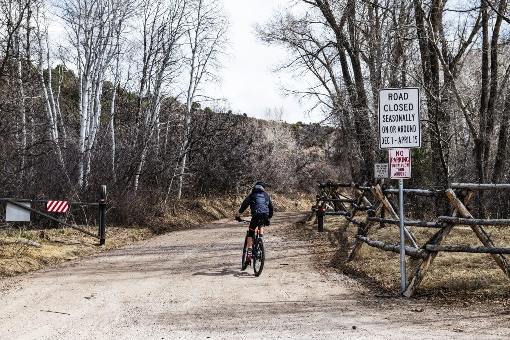 A biker rides down Prince Creek Road the day it reopened for the season in Carbondale on Wednesday, April 15, 2020.