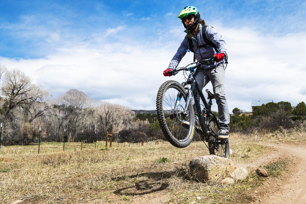 Josh Petersen jumps a rock feature on a trail at Prince Creek in Carbondale on Wednesday, April 15, 2020.