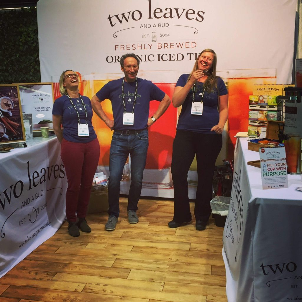Two Leaves and a Bud founder Richard Rosenfeld with sales managers Bess Hammer (of Basalt) and Jen Okeson (of New Jersey) at a trade show.