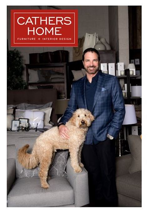 Paul Cathers, owner of Cathers Home, and his dog Stanley