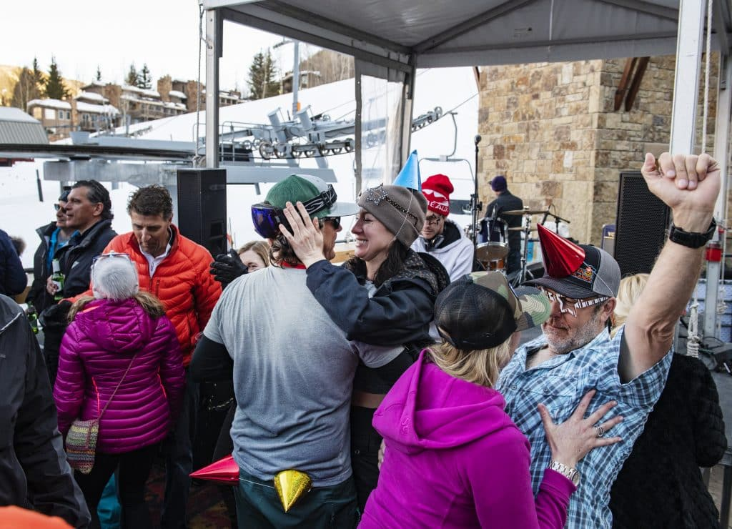People dance as a DJ performs at the Snow Lodge Aprés party on Thursday, March 5, 2020.