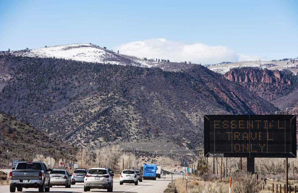A line of cars leave Aspen heading down valley on Tuesday, March 24, 2020.