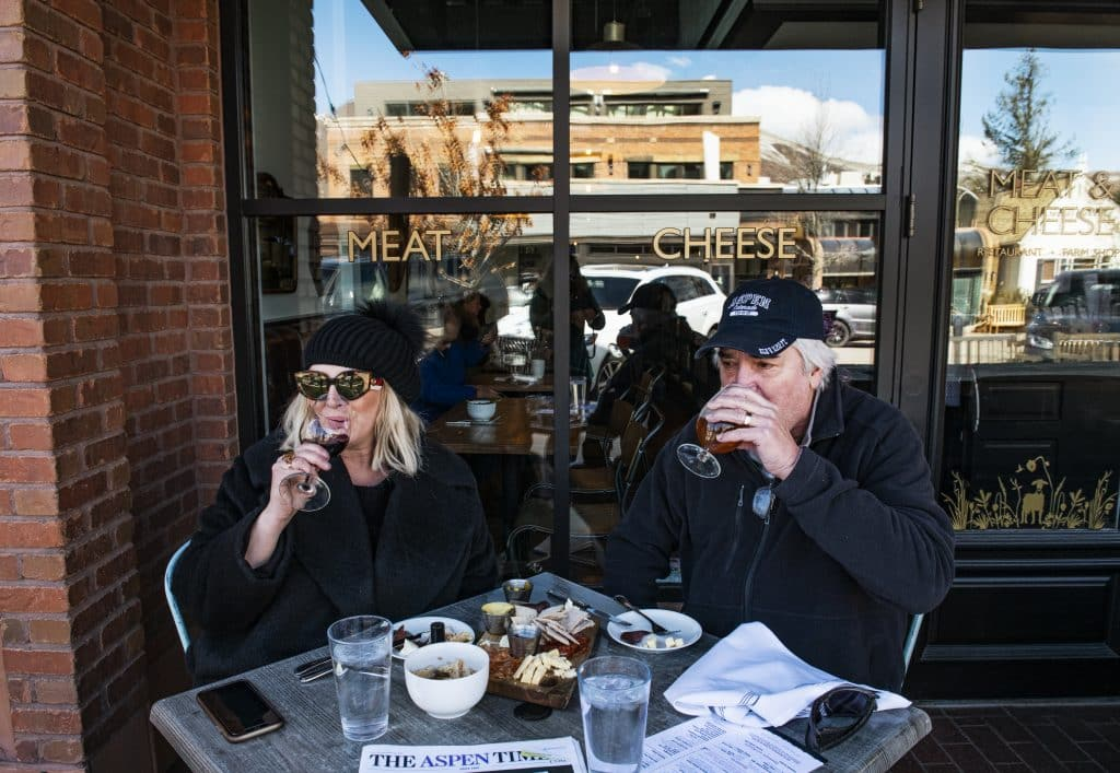 Polly and David Dunn enjoy lunch at Meat and Cheese during one of their stays in Aspen on Saturday, March 14, 2020.