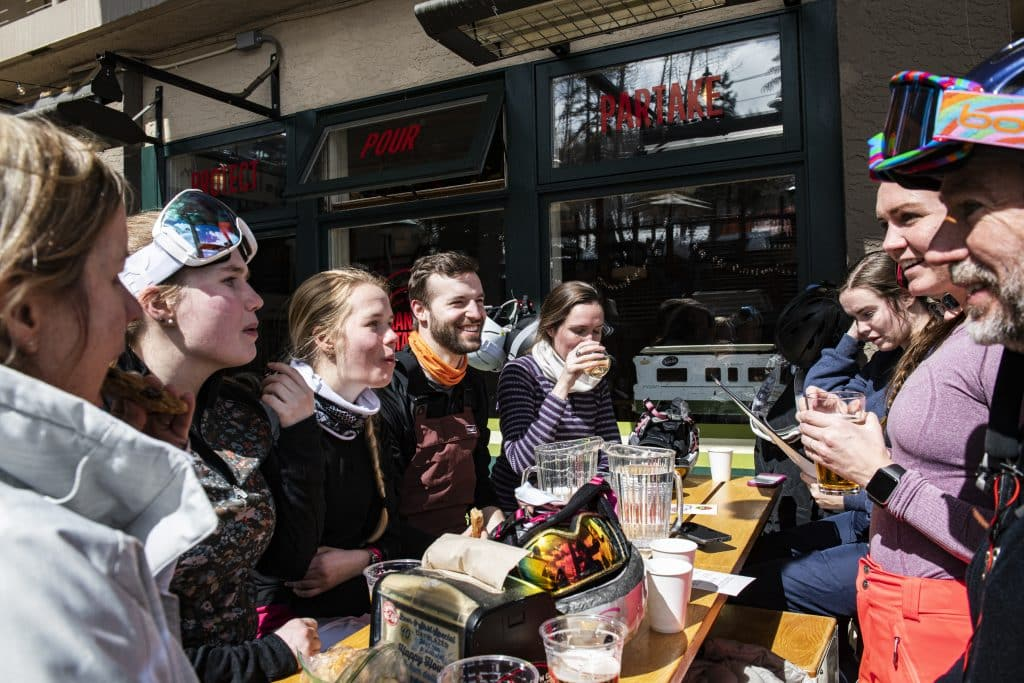 A family visiting from different cities enjoy Apres after skiing at the Ranger Station in Snowmass Village Mall on Saturday, March 13, 2020.