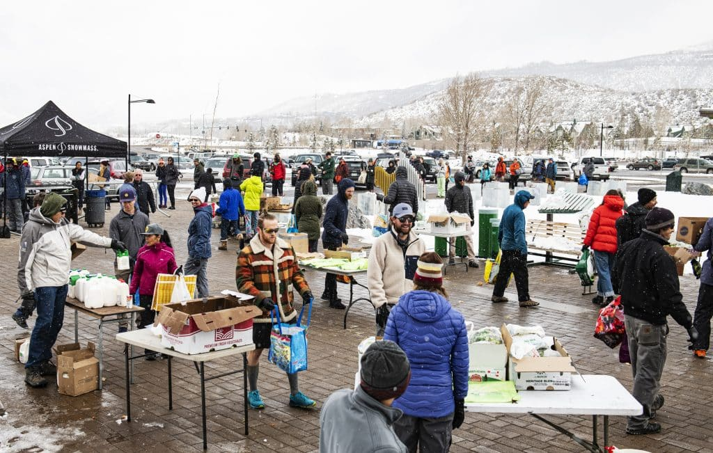 People move through the stations of free food at Buttermilk during a giveaway by Aspen Skiing Company on Friday, March 20, 2020.