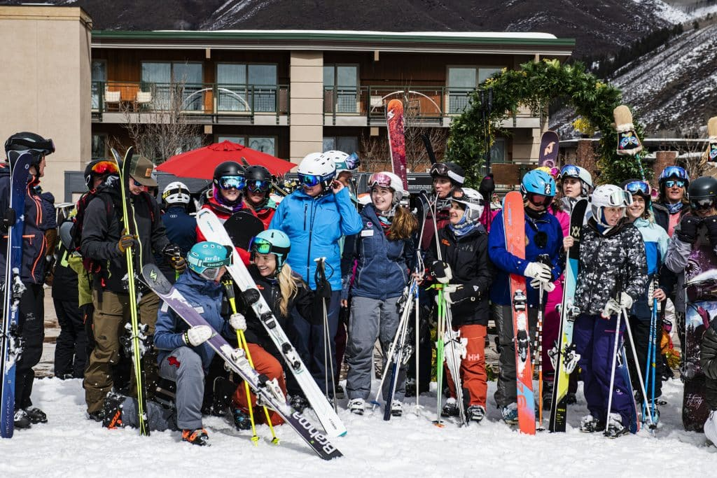 People gather for a group photo after the International Women's Day downhill parade at Aspen Mountain on Sunday, March 8, 2020.
