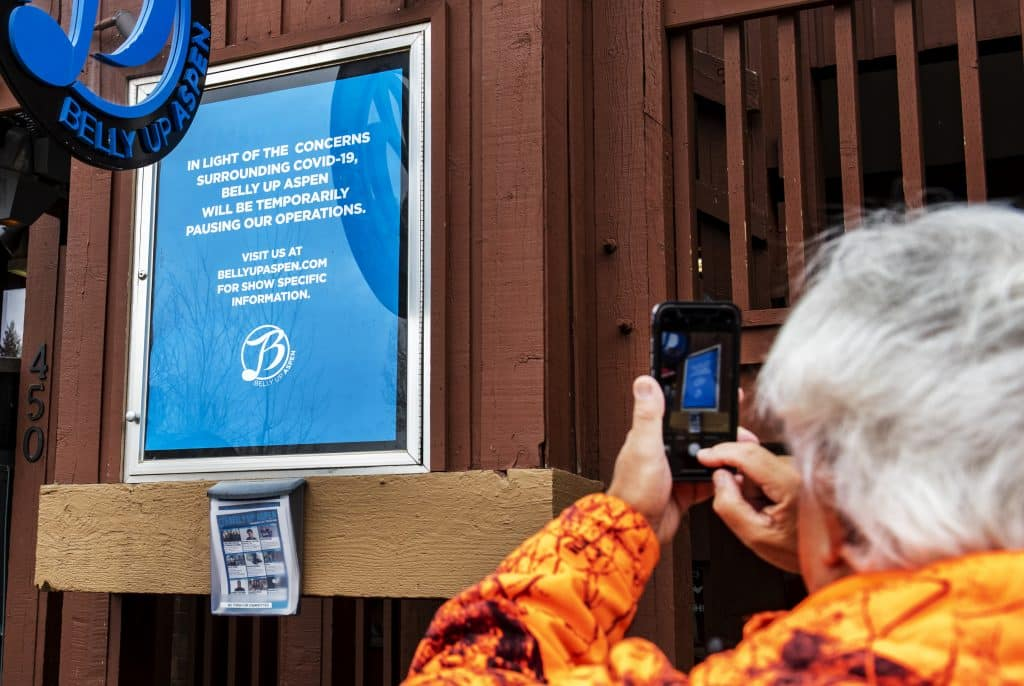 Richard Zuckerwar takes a photos of the closure sign outside of Belly Up Aspen on Thursday, March 12, 2020.