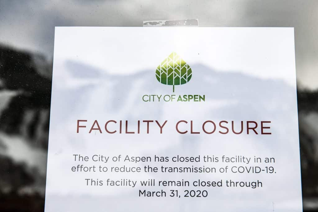 A sign hangs in the window of the Wheeler Opera House announcing closure through March 31 due to coronavirus on Thursday, March 12, 2020.