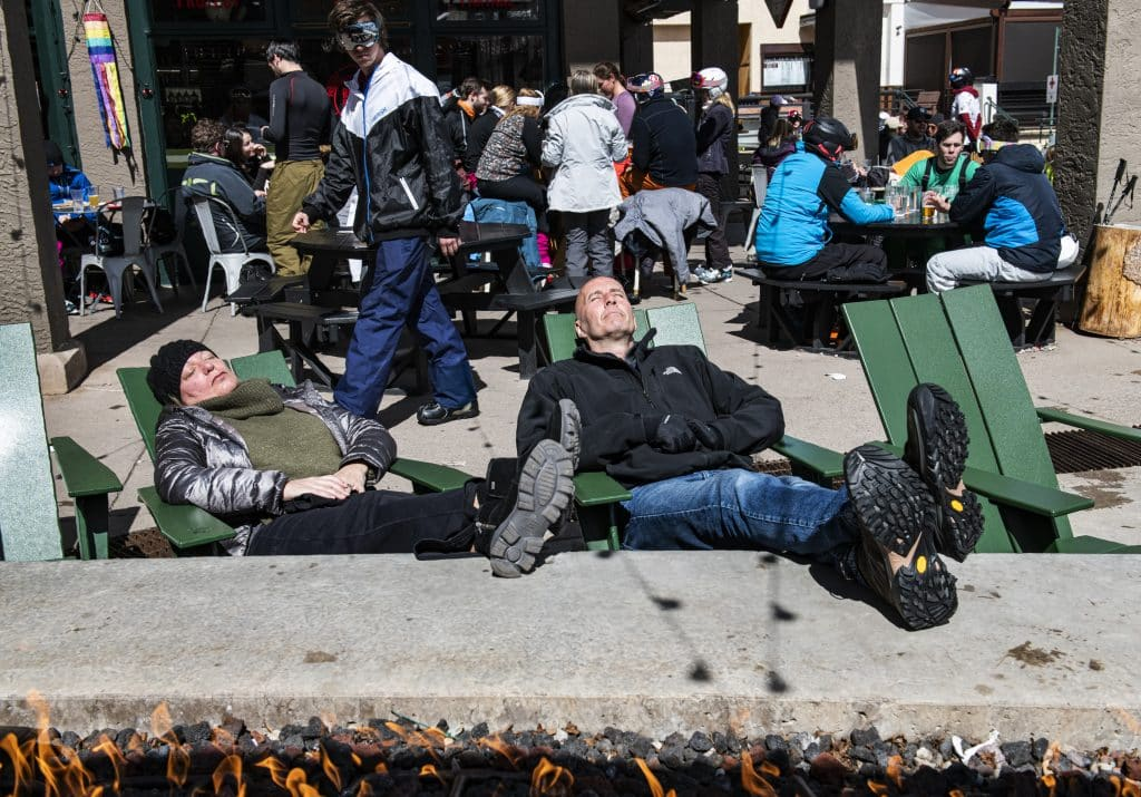 Beth Hubek, left, and Rob Hubek enjoy the sunshine at Snowmass Village Mall during their visit from Dallas on Saturday, March 14, 2020.