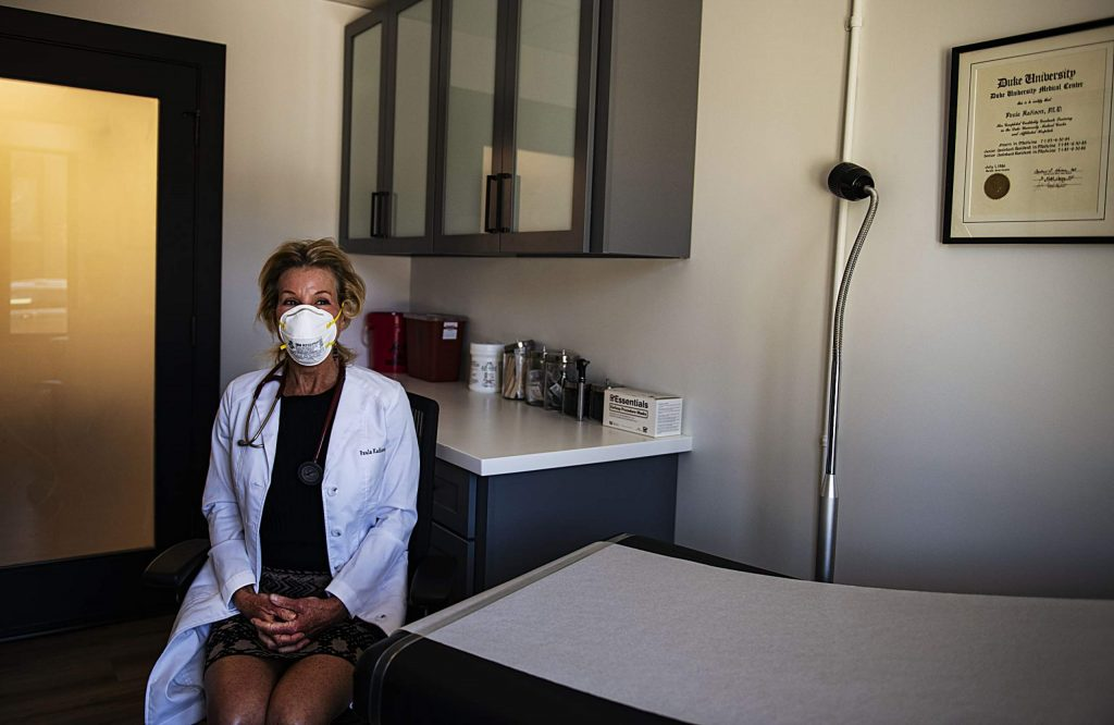 Dr. Paula Kadison sits in an examination room in her office at Madison Medical Group in Aspen on Thursday, April 9, 2020.