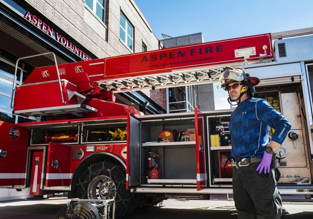 Aspen Volunteer Fire Department captain Sandy Schiff wears gloves while running truck checks outside of the fire house on Thursday, March 26, 2020. Schiff has been with the department for about six years.
