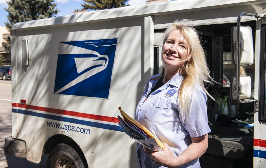 United States Postal Services city carrier Pam Thom delivers mail on Wednesday, April 1, 2020. Thom has been a city carrier in Aspen for 12 years. This was her first day back to work after a 14-day quarantine. Thom's husband came in contact with someone who had been exposed to someone who had been presumed positive with COVID-19. She said she started feeling symptomatic, but wasn't tested.