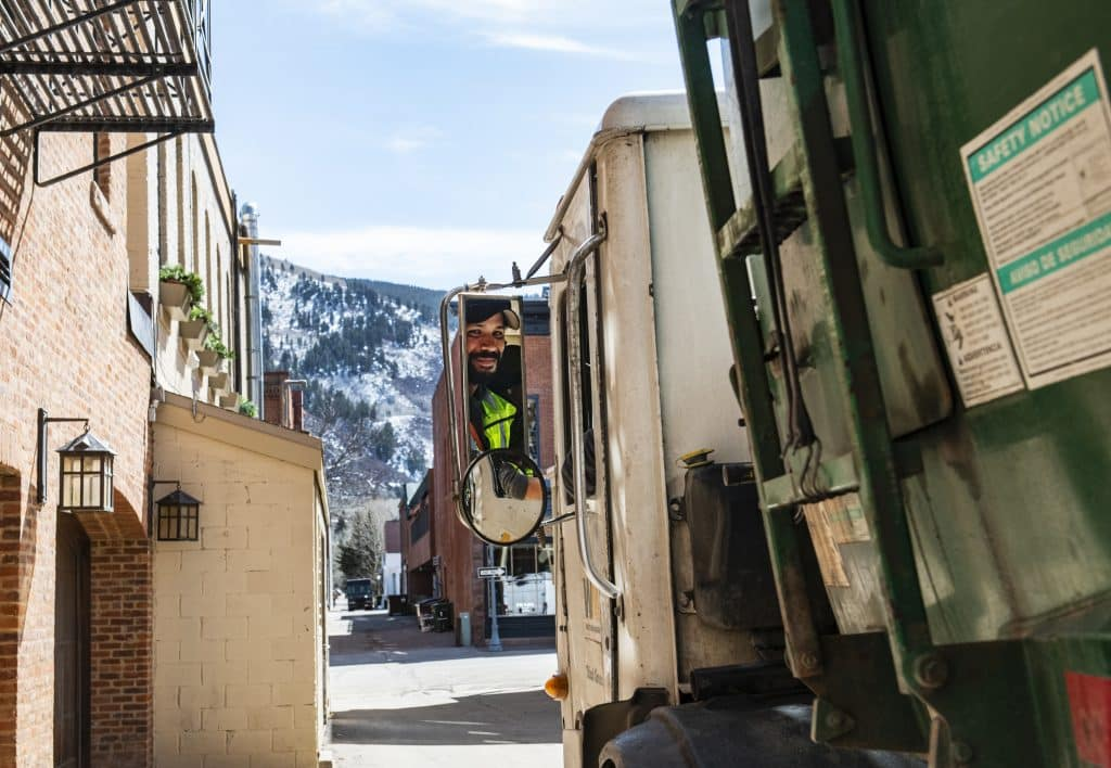 Waste Management driver Jorge Carballo pulls away after finishing at his stop behind Red Onion on Thursday, March 26, 2020. Carballo has worked for Waste Management for five years and is considered an essential employee.