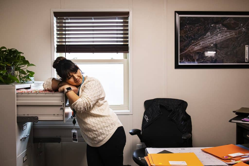 Aspen/Pitkin County Airport's credentialing and badging specialist Anais Hernandez works in her office on Thursday, April 2, 2020.