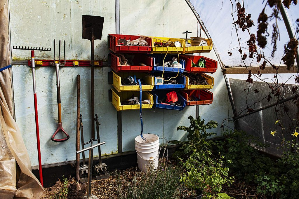 Farming tools are organized against the back wall of one o the greenhouses belonging to Wild Mountain Seeds in Carbondale on Thursday, April 2, 2020. (Kelsey Brunner/The Aspen Times)