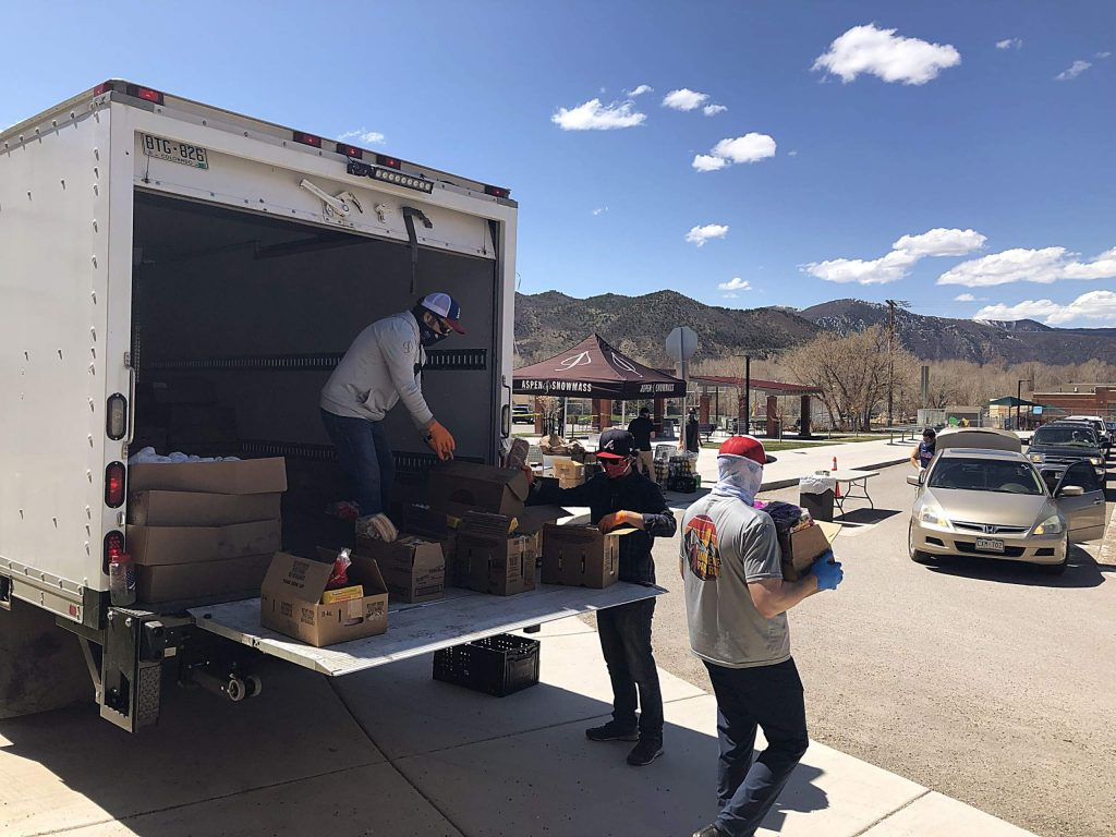 Aspen Skiing Co. employees unload food from a refrigeration truck Thursday as part of the distribution for Food Bank of the Rockies. The food is provided each Thursday from noon until 2 p.m. at Basalt Middle School.