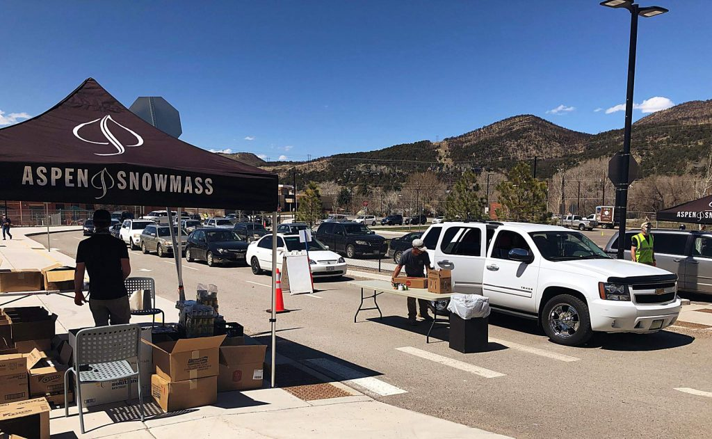 Two lines of vehicles wait for their turn to load up food provided by Food Bank of the Rockies and distributed by volunteers from Aspen Skiing Co. on Thursday. Even food is provided at the Basalt Middle School noon to 2 p.m. each Thursday.