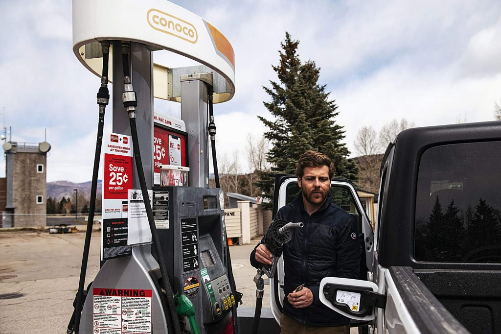 Burlingame resident Filipe Rocha fills up his tank at the Conoco station in the Aspen Business Center on Tuesday, April 14, 2020. (Kelsey Brunner/The Aspen Times)
