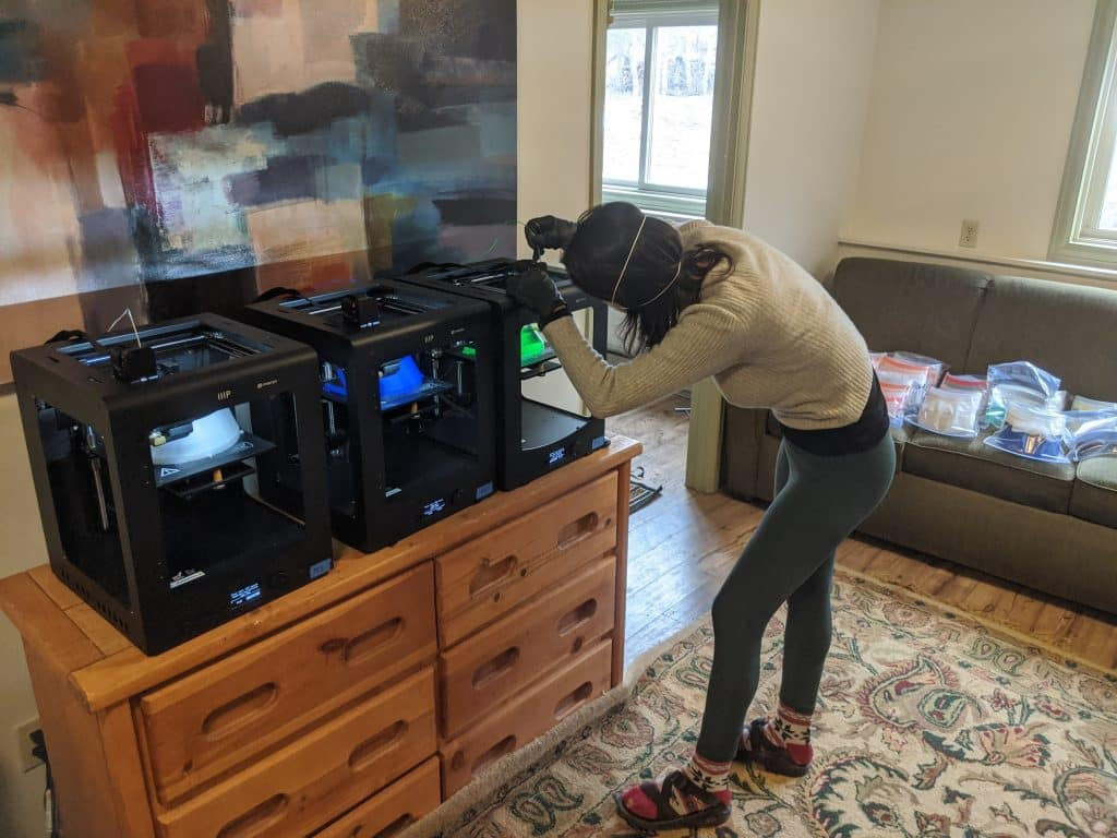 Anderson Ranch's Leah Aegerter makes medical face shields with a 3D printer in her home.
