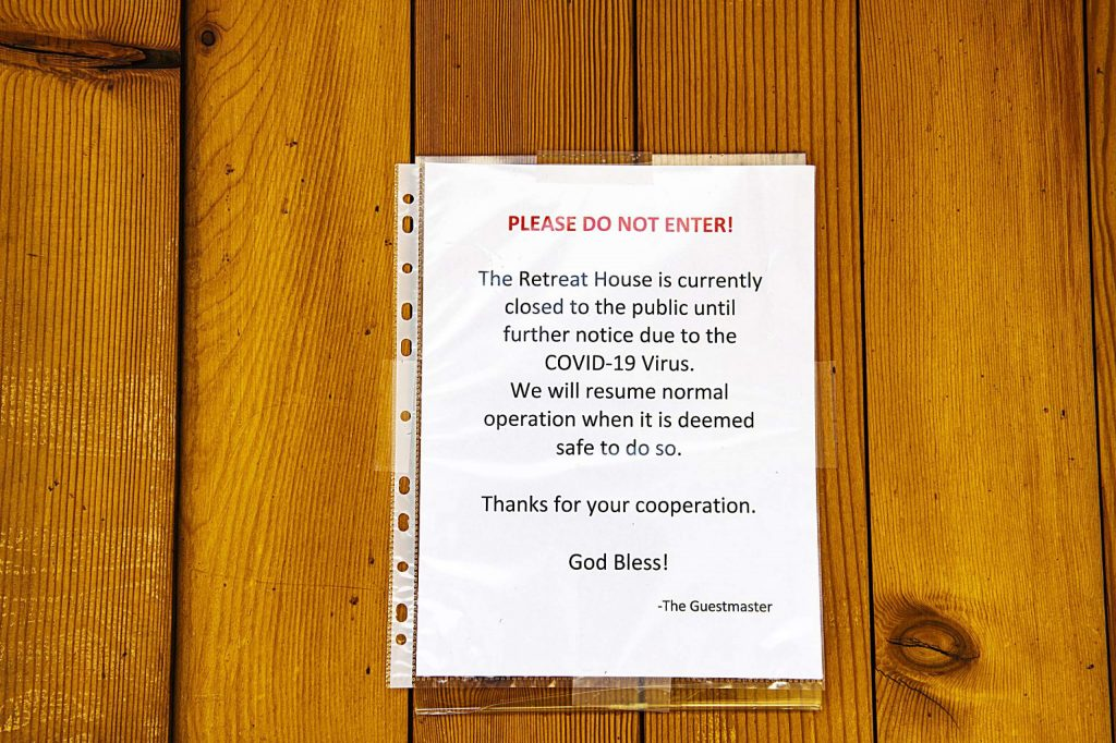A sign announcing the closure of The Retreat House hangs on a door at St. Benedict's Monastery in Old Snowmass on Tuesday, April 14, 2020. (Kelsey Brunner/Snowmass Sun)