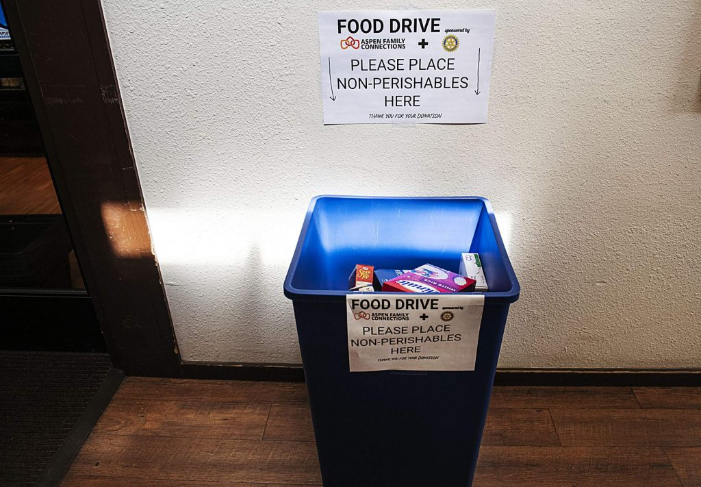 The Aspen Family Connections non-perishable food drive bin sits outside of Clark's Market in Snowmass on Tuesday, April 21, 2020. (Kelsey Brunner/The Aspen Times)