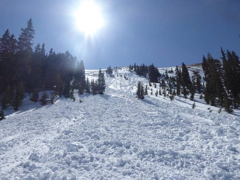 Looking up the avalanche path where a snowmobiler was caught, carried, and injured on April 7.