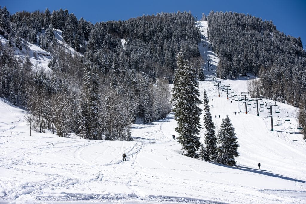Uphillers wade through over 15 inches of accumulated powder on a blue bird day at Aspen Highlands on Friday, April 17, 2020.