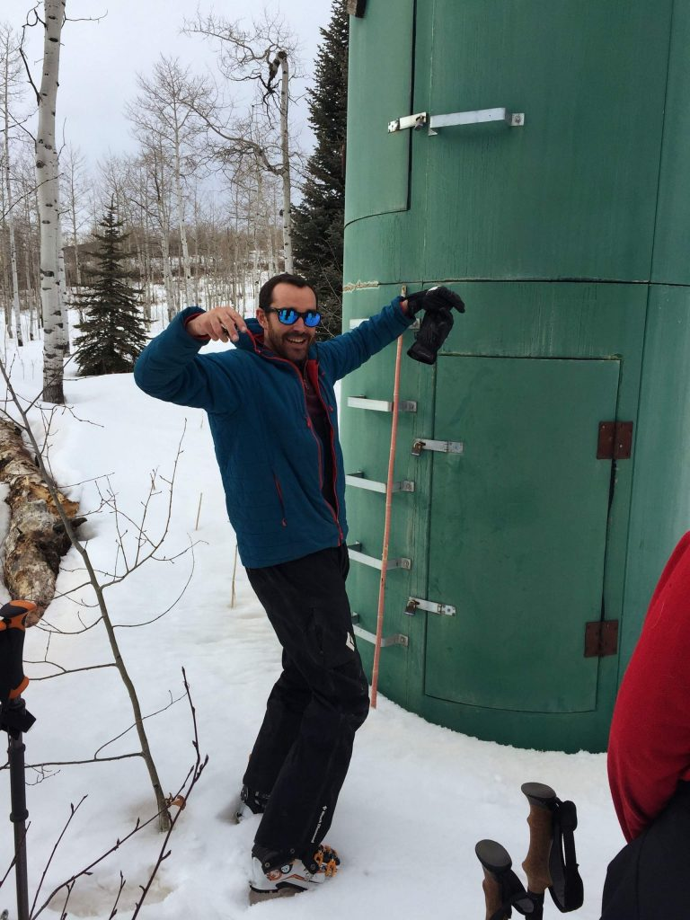 Karl Wetlaufer, a hydrologist with the National Resources Conservation Service, explains how this SNOTEL site on McClure Pass works. Scientists use these remote sensing sites to estimate the snow-water equivalent of the snowpack and predict spring streamflows.