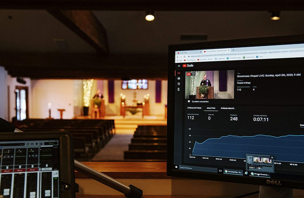 A youtube screen shows that over 100 people are tuned in to Robert de Wetter's service in the Snowmass Chapel on Sunday, April 5, 2020.