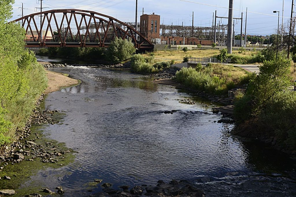 The South Platte River runs by an electricity plant near I-25 in Denver. A project proposed by the South Platte Regional Opportunities Water Group would allow Front Range water managers to maximize the reuse of Colorado River water.