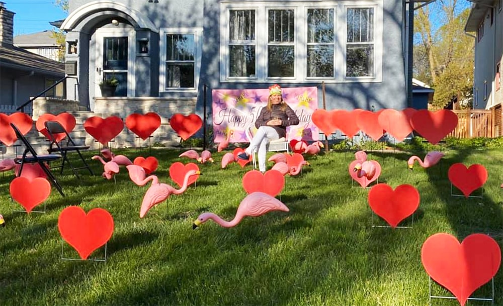 Chris Hutcheson turned 50 with flamingos and hearts planted by friends across her front lawn.