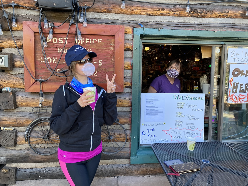 Lynn Chaffier gets a Margarita at Woody Creek Tavern from Amy Young in the window.
