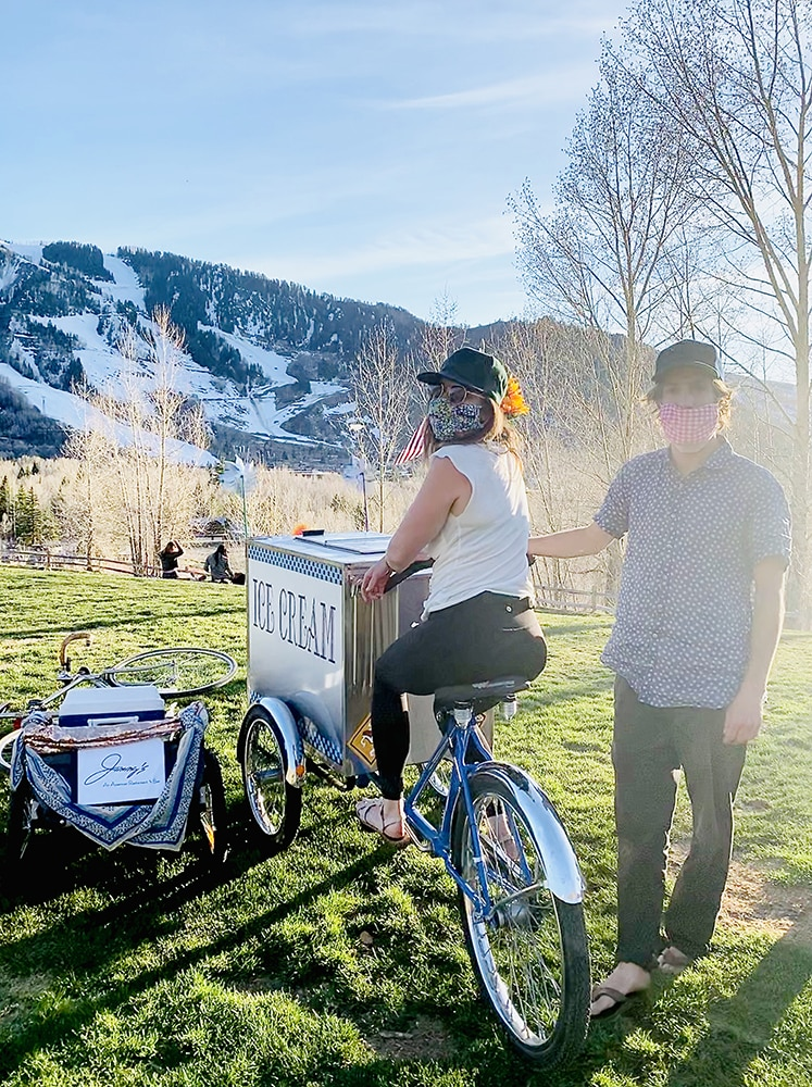 Kayla Feld and Oliver Bacharach on their mobile delivery bikes.