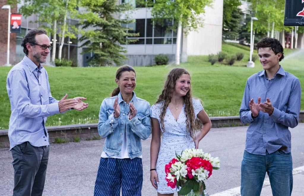 Aspen High School's Valedictorian Quinn Ramberg, center right, stands with her family as her honors and scholarships are announced during the drive-through event at Aspen School District Campus on Thursday, May 28, 2020.