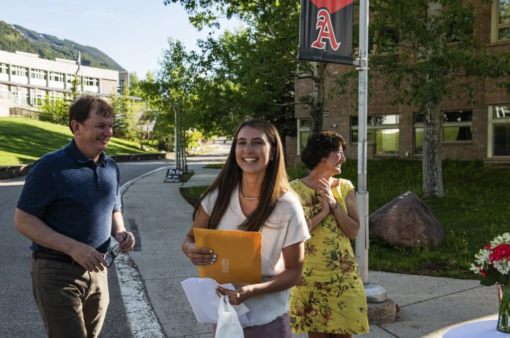 Kat Goralka, center, walks back to her car with her parents Mike and Caryn after receiving her scholarships and salutatorian honors during the scholarship drive-through event on Thursday, May 28, 2020. (Kelsey Brunner/The Aspen Times)