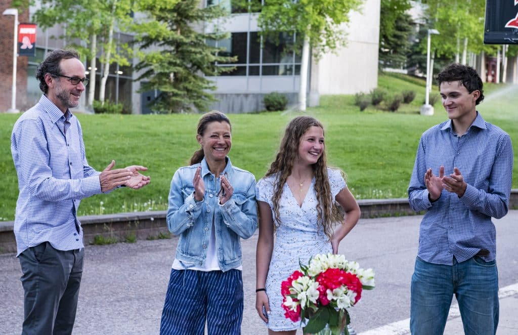 Aspen High School valedictorian Quinn Ramberg, center right, stands with her family as her honors and scholarships are announced during the drive-through event at Aspen School District Campus on Thursday, May 28, 2020. (Kelsey Brunner/The Aspen Times)