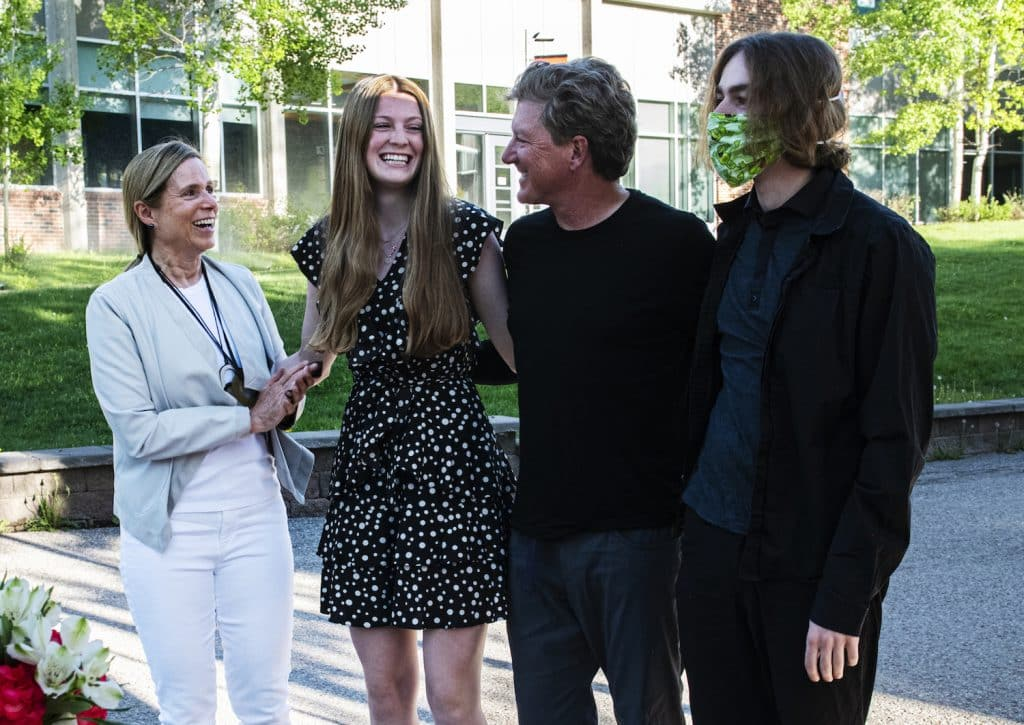 Aspen High School's Maxine Mellin, center left, stands with her family as her scholarships are announced during the drive-through event at Aspen School District Campus on Thursday, May 28, 2020. (Kelsey Brunner/The Aspen Times)