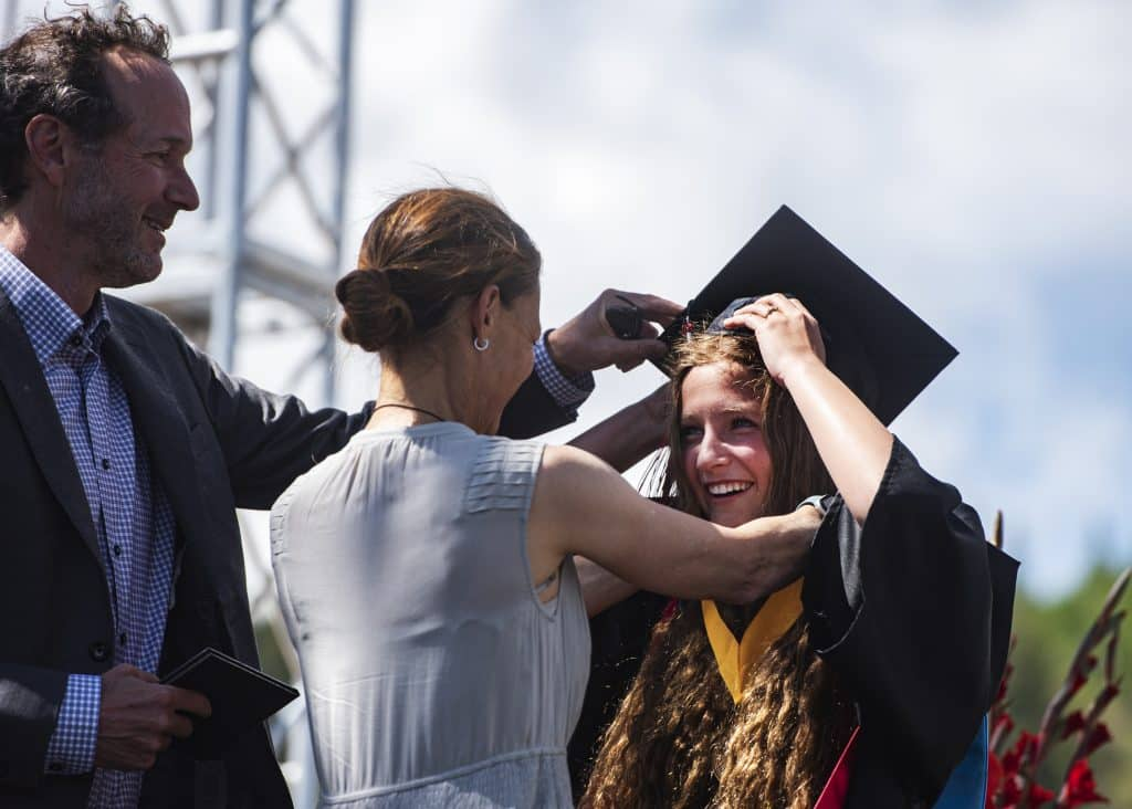 Valedictorian Quinn Ramberg and her family stand on stage as she's introduced during Aspen High School's graduation at Buttermilk on Saturday, May 30, 2020.