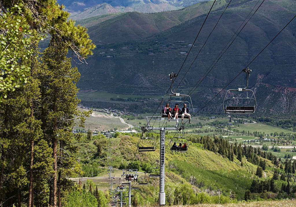 Graduates ride the Summit Express lift to the top of Buttermilk after the official Aspen High School graduation ceremony at Buttermilk on Saturday, May 30, 2020. (Kelsey Brunner/The Aspen Times)