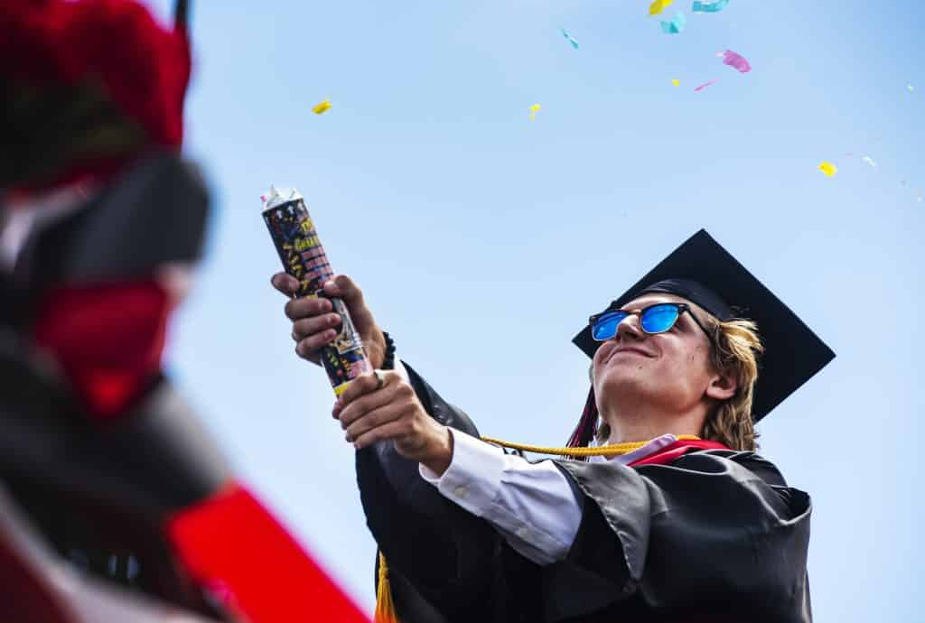 Richie Simeone pops confetti after crossing the stage during Aspen High School's graduation at Buttermilk on Saturday, May 30, 2020.