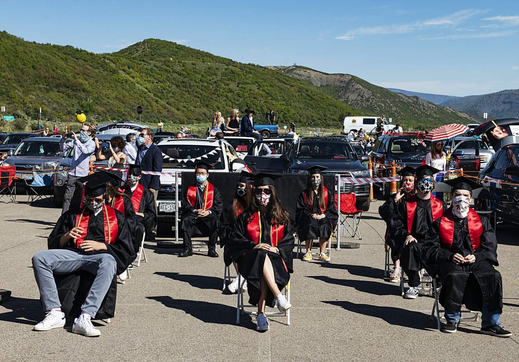 Graduates and parents watch the Aspen High School's graduation ceremony while social distancing at Buttermilk on Saturday, May 30, 2020. (Kelsey Brunner/The Aspen Times)